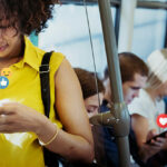 Salt Rank Digital Marketing Kansas City people on bus on smartphones