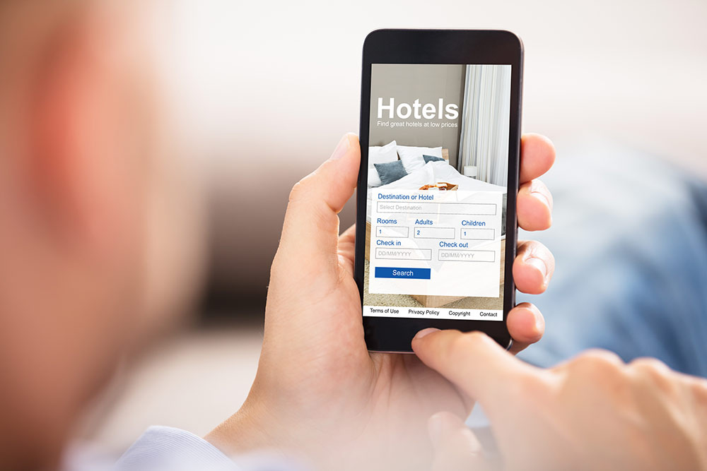 Person on smartphone looking at hotel landing page