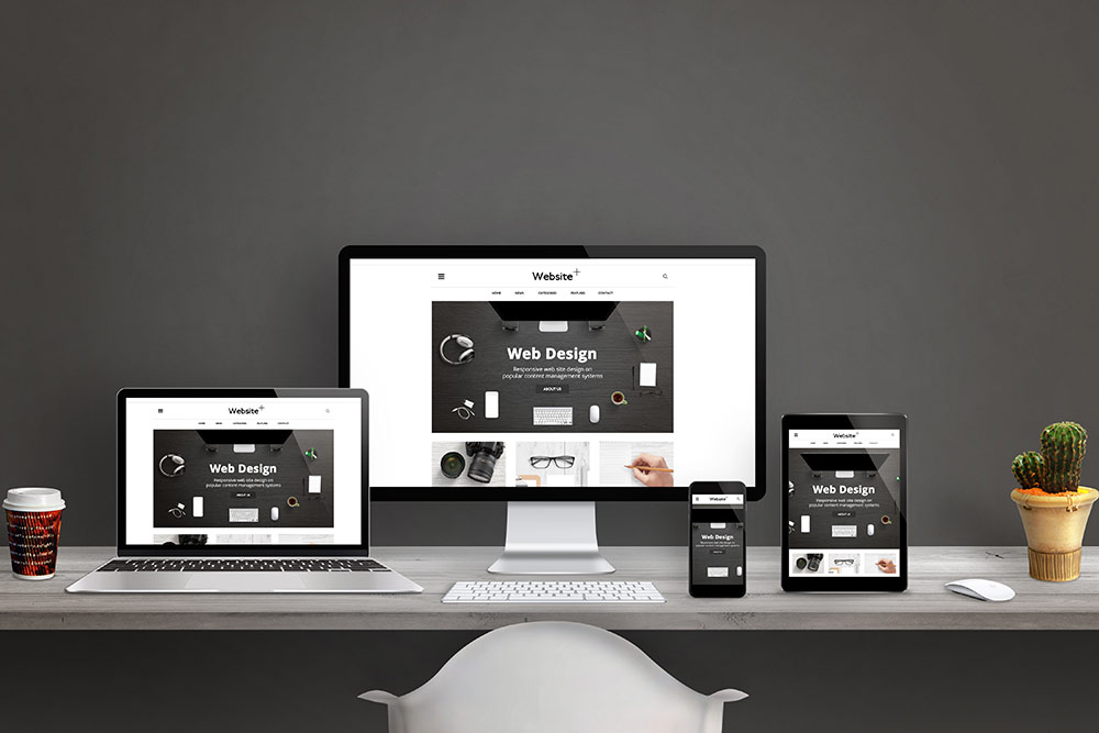 Website design across multiple devices, desktop monitor, laptop, tablet and smartphone