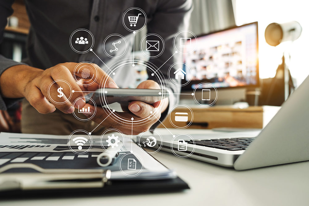 Man on tablet with digital marketing icons around in circle