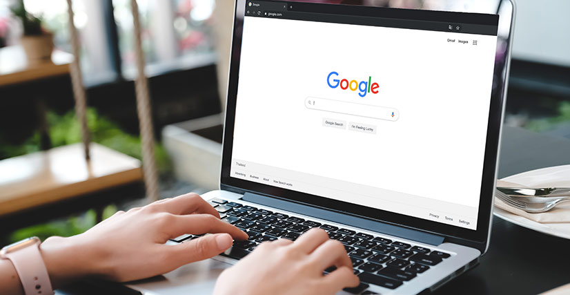 Woman on laptop searching on Google
