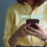 Woman on smartphone with search bar