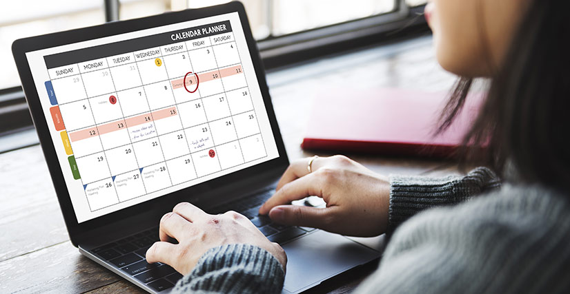 Close up of woman on laptop showing social media calendar, digital marketing services